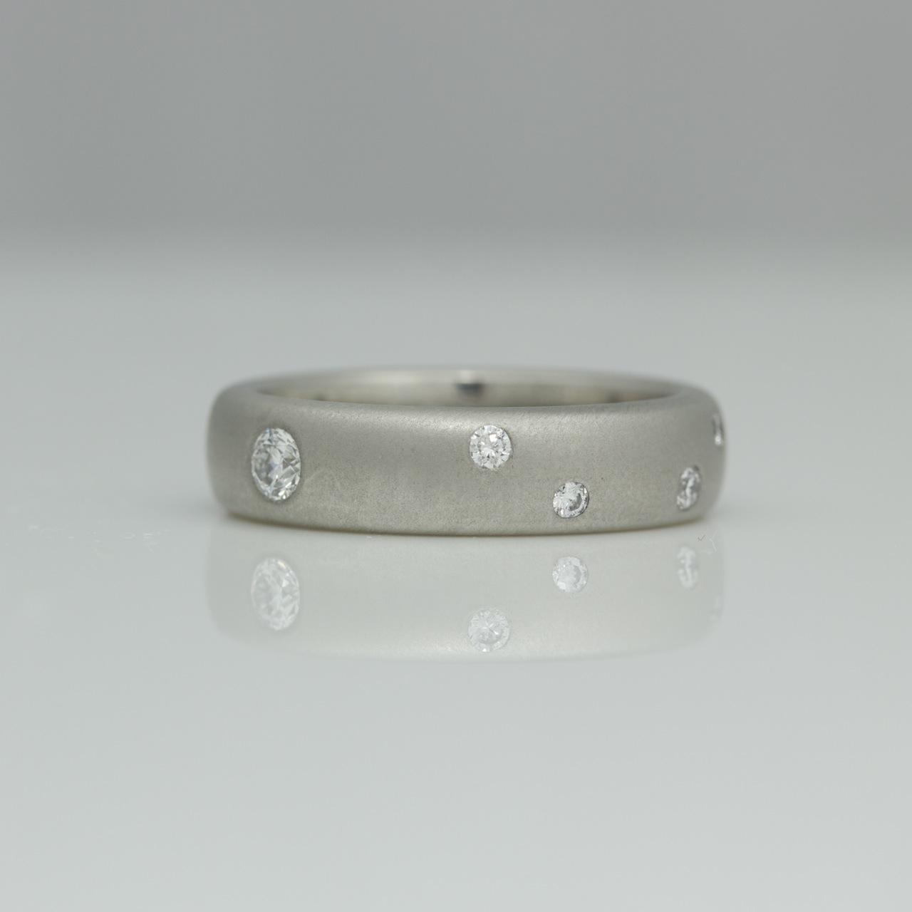 modern diamond eternity ring platinum with flush set diamonds