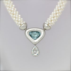 Blue and white diamond necklace in platinum on pearls Blue and white diamond necklace in platinum on pearls. The finest contemporary jewellery handmade in London bespoke