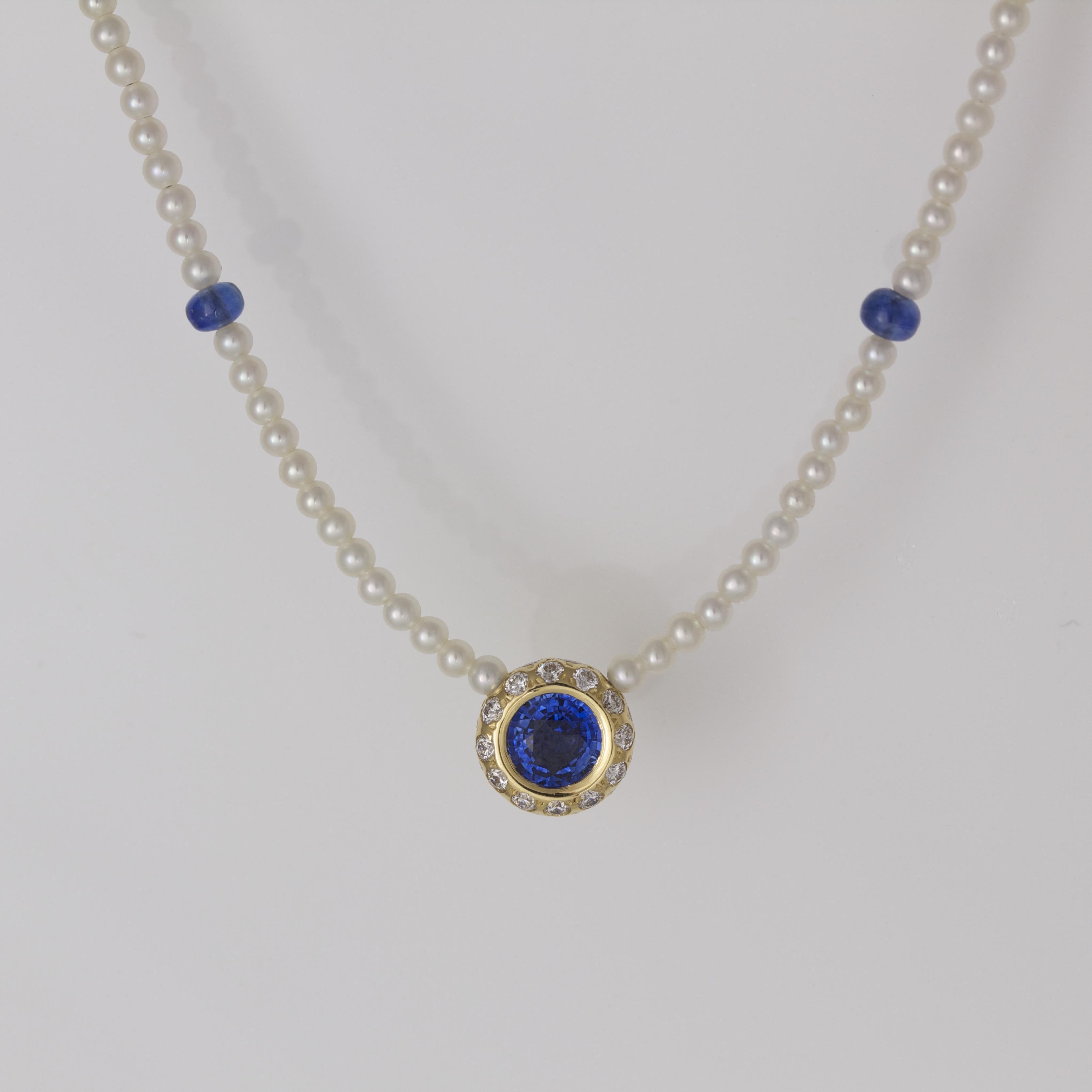 Sapphire with diamond halo necklace DAVID ASHTON