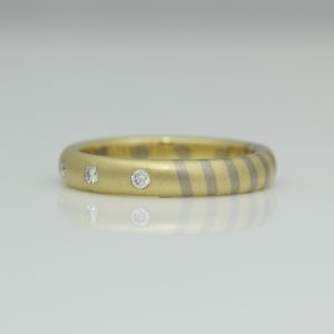 18ct yellow and white gold thirds ring