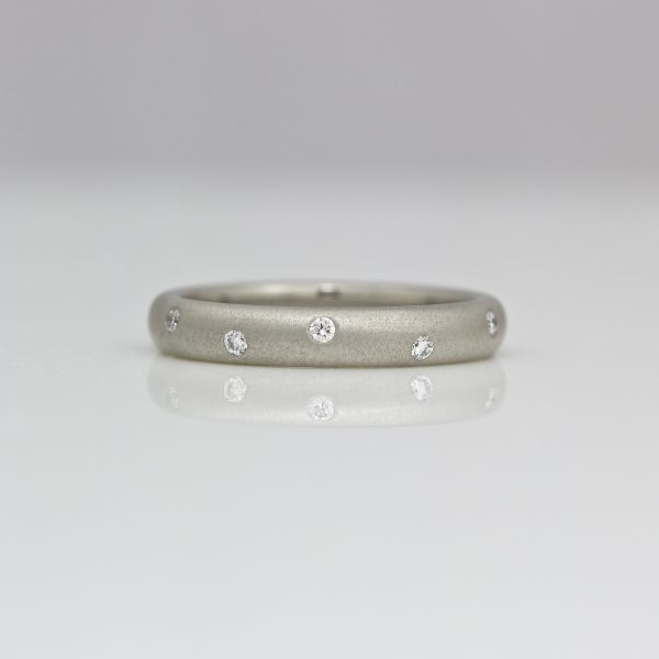 Modern platinum eternity ring