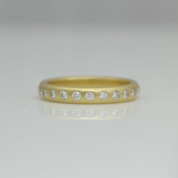 24 diamonds flush set in 18ct gold eternity ring