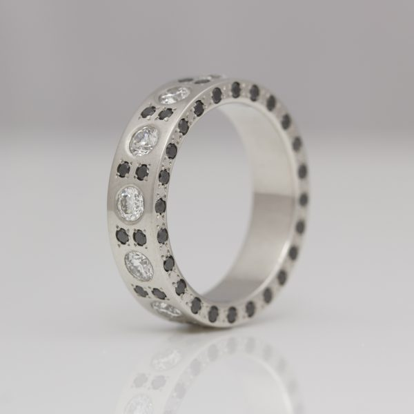 Platinum ring with black & white diamonds on all edges