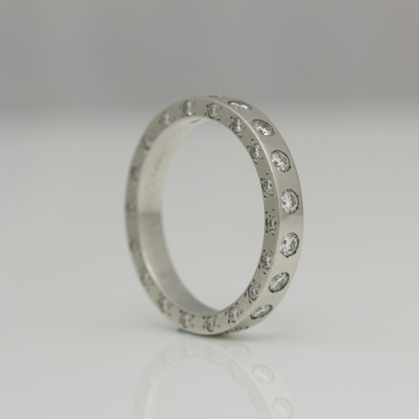 Platinum ring with diamonds set on all edges