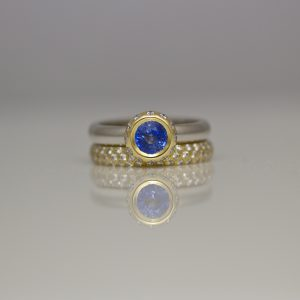 Sapphire framed with diamonds ring
