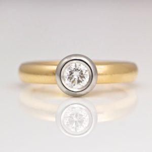 Diamond rub-over set in Platinum on rose gold engagement ring