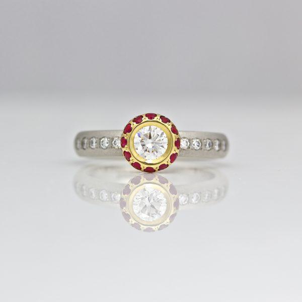 Diamond framed with rubies on a diamond set platinum ring