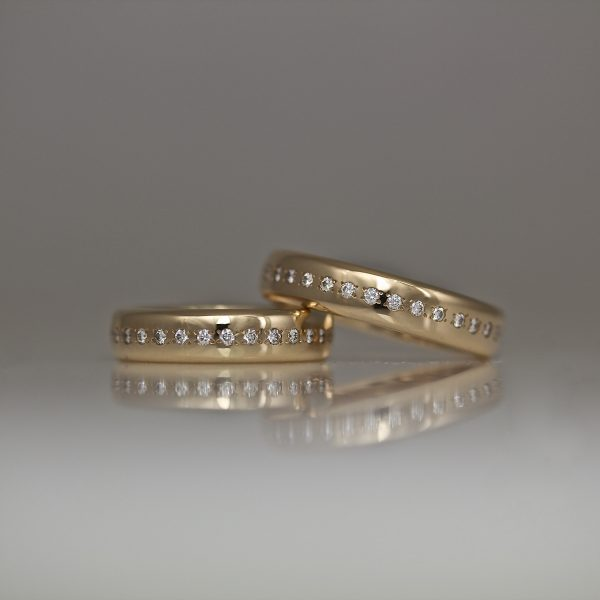 Rose gold eternity ring with a single row of pave set diamonds