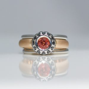 Orange sapphire & black diamond low set rub-over triple ring