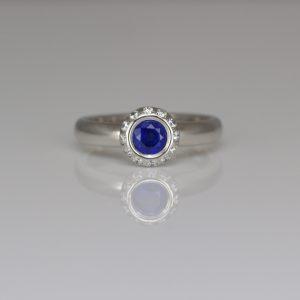 Blue sapphire with diamond halo platinum ring