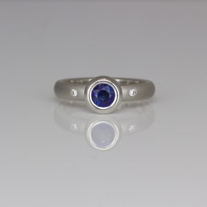 Sapphire rub-over set in platinum ring