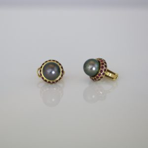 Tahitian pearls, with the finest rubies set in yellow gold contemporary ear-studs