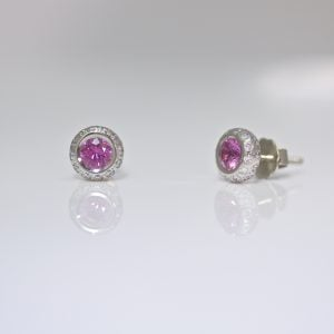 Pink sapphire with diamond ear-studs
