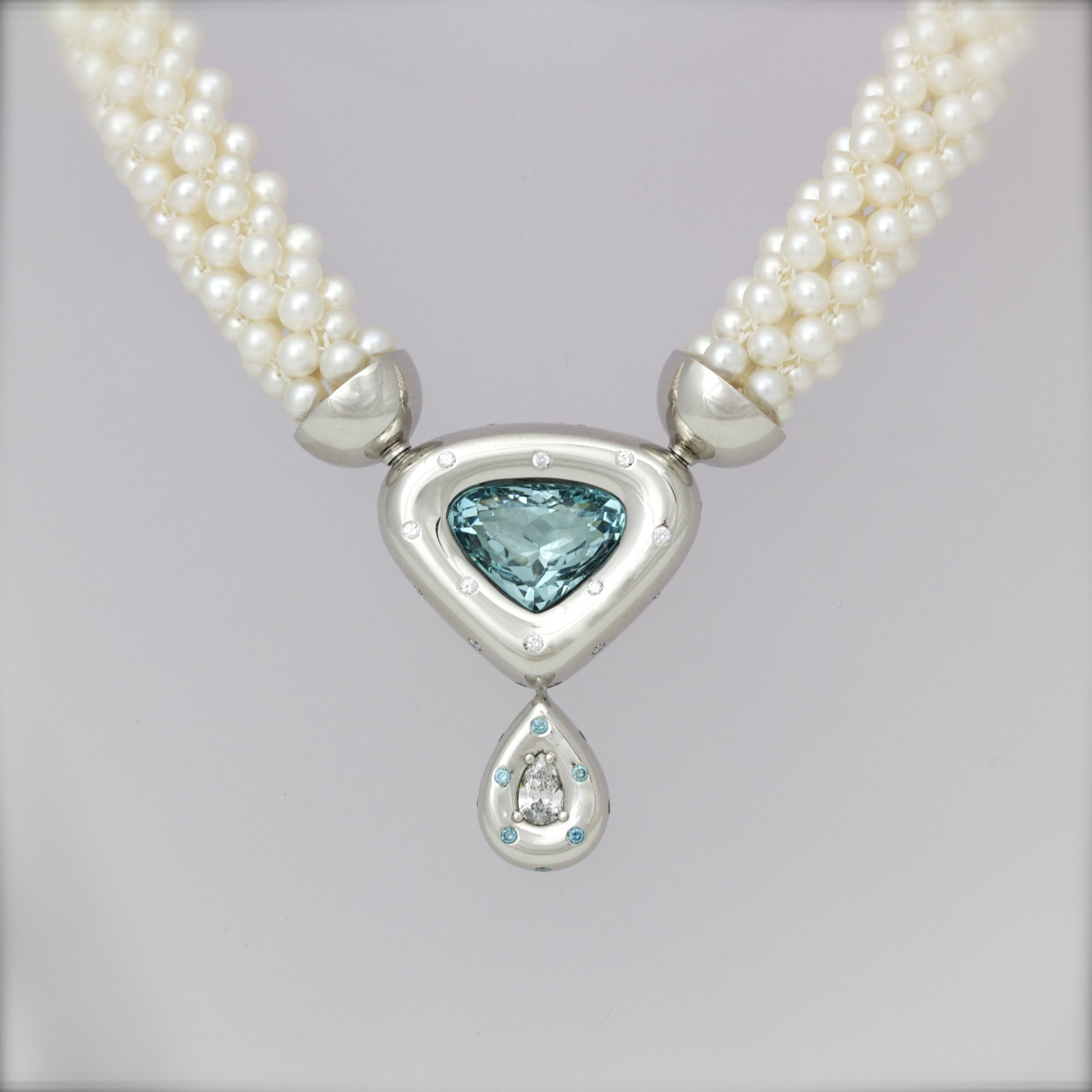 Blue & white diamond necklace in platinum on pearls