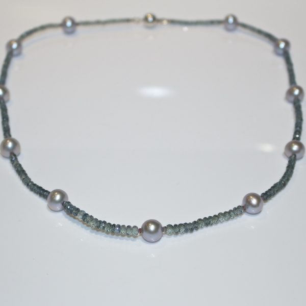 Colour change sapphire with pearl necklace
