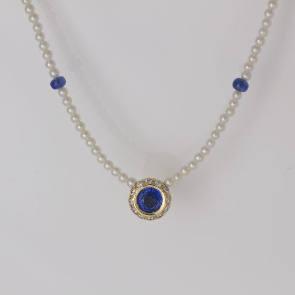Sapphire with diamond halo necklace
