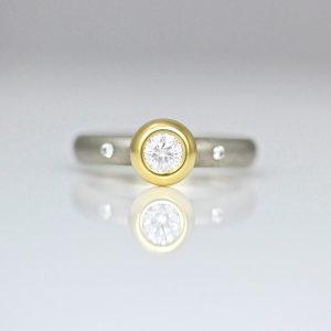 rub-over set diamond engagement ring